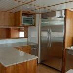 Large Kitchen Area with Fridge on Boat